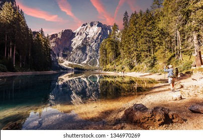 Wonderful sunrise view of Braies lake. Dramatic Unusual Scene. Colorful Sky over lago di Braies in Dolomites Alps. Awesome Alpine Highlands during sunset. Amazing nature Landscape at Summer Day.