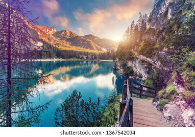Wonderful sunrise view of Braies lake. Dramatic Unusual Scene. Colorful Sky over lago di Braies in Dolomites Alps. Awesome Alpine Highlands during sunset. Amazing nature Landscape at Summer Day