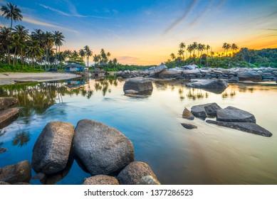 Wonderful sunset on the beach of Pengudang Village Bintan island