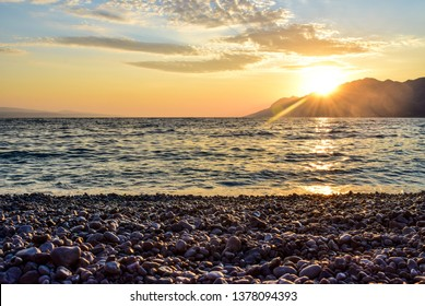 Wonderful sunset on the Punta Rata Beach, Brela, Croatia.
