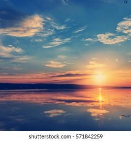 wonderful sunset over the lake. instagram filter