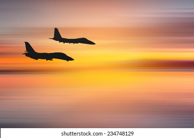 Wonderful sunset over Santa Monica,California with two fighter jets. Abstract piece of art with motion blur