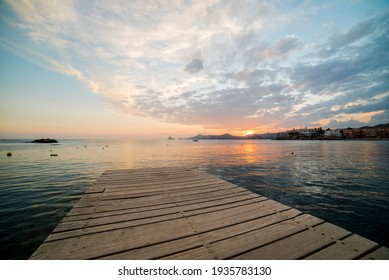 Wonderful sunset from a pier in Calabardina, Aguilas, Spain
