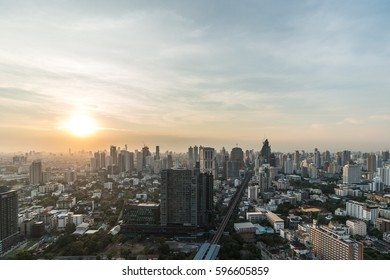 Wonderful sunset view of bangkok sukhumvit skyscrapers from a rooftop.