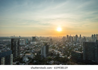 Wonderful sunset view of bangkok sukhumvit skyscrapers from a octave rooftop.