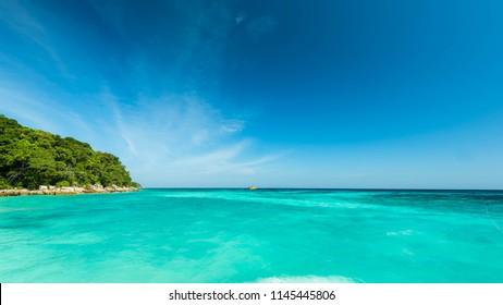 Wonderful turqoise sea at Andaman sea, Beautiful beach and gentle wave at Surin Island, Thailand
