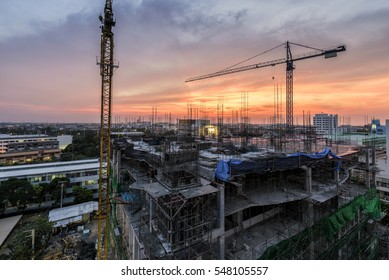 Wonderful Twilight of a New Hospital Building being constructed with big cranes at Chonburi Hospital, Chonburi Province, Thailand