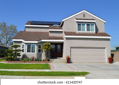 A wonderful two storey cottage with solar panels on the roof. Artesia,CA.