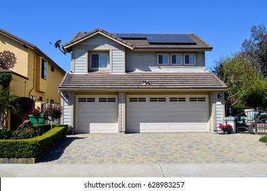 A wonderful two story cottage with solar panels on the roof. Del Mar City, California.