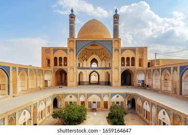 Wonderful view of Agha Bozorg Mosque on blue sky background in Kashan, Iran. The historical mosque and madrasa is a popular tourist attraction of the Middle East.