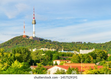 Wonderful view of Namsan Seoul Tower on Namsan Mountain in Seoul, South Korea. The tower is a popular tourist attraction of Asia. Scenic sunny cityscape.