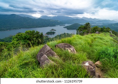 Wonderful view on Knuckles Mountain Range and Victoria Resevoir near Kandy, Sri Lanka with some nice rocks on the foreground.