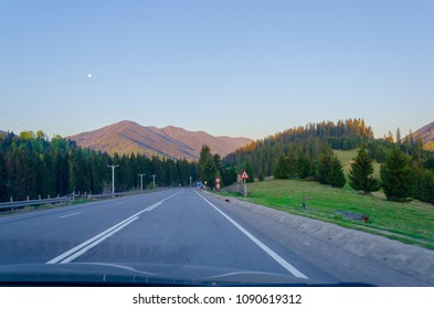 Wonderful view on road at the sunset - travelers photo from car