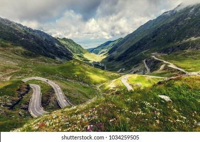 wonderful view on Transfagarasan Road with overcast dramatic sky. Transilvania. Fagaras Ridge. Carpathian mountains. East Europe. Beauty in the World. Travel Adventure Conception