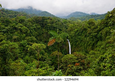 Wonderful view over Costa Rican rain forest. La Fortuna waterfall on background.