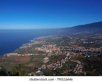 wonderful view over the orotava valley on the north coast of tenerife, high above puerto de la cruz, La orotava and Los Realejos, in the background the dark blue Atlantic Ocean in the sunlight