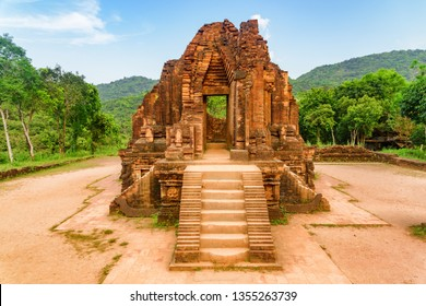 Wonderful view of red brick temple of My Son Sanctuary among green woods in Da Nang (Danang), Vietnam. My Son is a complex of partially ruined ancient Hindu temples constructed by the kings of Champa.