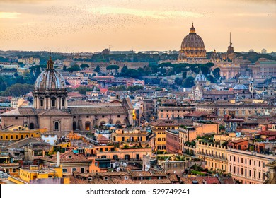 Wonderful view of Rome skyline at sunset time with St Peter Cathedral