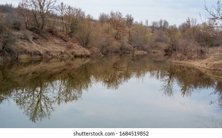Wonderful view of small lake. A lake in the forest. Reflections over the water.