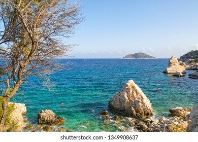 Wonderful views of the turquoise Mediterranean and the rocky shore surface in Firnaz cove of Kalkan. July 2018, Antalya-Turkey