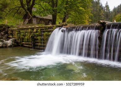 Wonderful water cascade in a watermill village in Kvacianska dolina, Oblazy, Slovakia