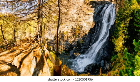 Wonderful waterfall in the forest in the mountains during the autumn season with light and shadows in the undergrowth