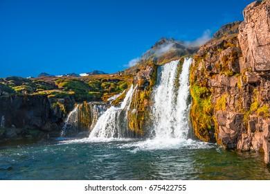 Wonderful waterfall Kirkjufellsfoss in Iceland, Autumn colors, close up