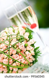 Wonderful wedding luxury bouquet of roses and glasses of champagne.