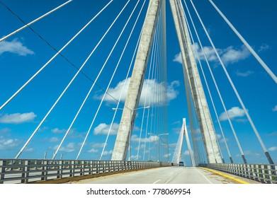 Wonderful white bridge structure over clear blue sky. Mauricio Baez Bridge, a cable-stayed bridge near San Pedro de Macoris, Dominican Republic, is one of the most modern and beautiful bridges in the