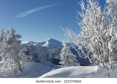 Wonderful Winter Landscape. Awesome Alpine Highlands in Sunny Day. Christmas holyday concept. Winter mountain forest. Snowy mountains and perfect blue sky. Amazing Nature background. postcard