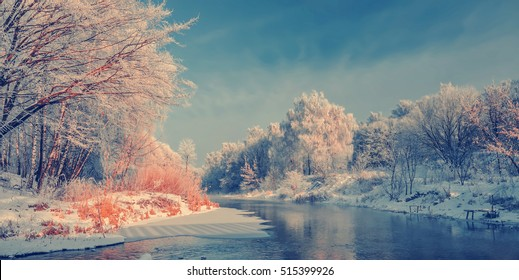 wonderful winter scene. Frosty, misty morning on the small river. frost covered trees in the warm glow of sunrise on the beach. The beauty of the world. Europe. Ukraine. Ternopol. instagram filter