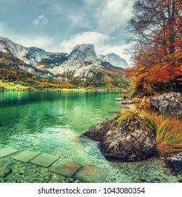 Wonderfull Alpine landscape. Awesome Austrian Alps Scenery. Famouse mountain lake Grundlsee during in autumn.