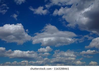 Wonderfull clouds in the deep blue summer sky