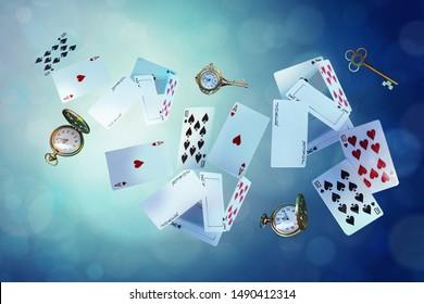Wonderland background. Playing cards, pocket watch, key,  falling down the rabbit hole. Horizontal banner.