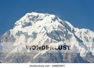 WONDERLUST word over the background of the mountain. Concept for self belief, challenge, positive attitude and motivation quotes for Travel and Adventure.