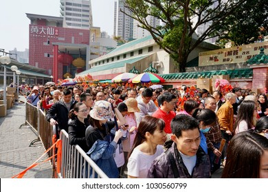 Wong Tai Sin, Kowloon, Hong Kong - 16 Feb 2018: Tones of people moving in the crowd to enter the famous Wong Tai Sin Temple to celebrate the Chinese New Year.