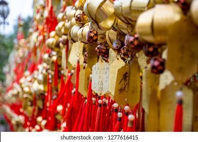 Wong Tai Sin temple, HONG KONG - 1 December 2018: Chinese golden shiny amulet along on wall for prayers at Wong Tai Sin temple