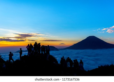 WONOSOBO, INDONESIA - September 1, 2018: Travellers are waiting for the sunrise from the top of the Hill sikunir Dieng