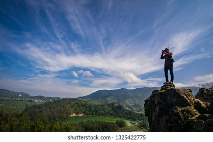 Wonosobo, Indonesia : Tourist taking picture of Telaga Warna, a beautiful lake in Dieng Plateau area, a popular tourist destination in Wonosobo Regency, Central Java, Indonesia (02/2019).