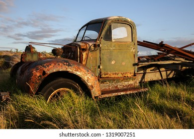 WONTHAGGI, VICTORIA, AUSTRALIA - 26 FEBRUARY 2016: A derelict old truck bathed in the light of early sunset sits forlorn in a field near Wonthaggi in South Gippsland, Victoria.