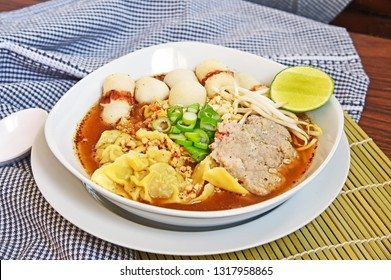 Wonton Thai Tomyum or spicy sour soup with fish ball and pork.