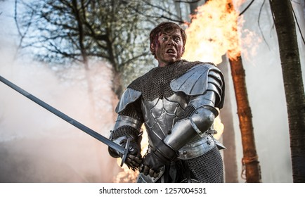 In a wood 5 miles outside Tring, Hertfordshire, England - 05 01 2013: The actor Rupert Grint in a fight scene on the set of Instruments of Darkness, a dramatisation of Macbeth
