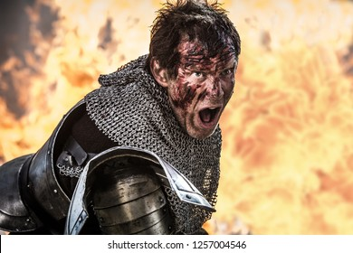 In a wood 5 miles outside Tring, Hertfordshire, England - 05 01 2013: The actor Jason Flemmyng in a fight scene on the set of Instruments of Darkness, a dramatisation of Macbeth