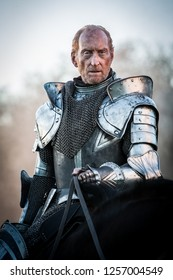 In a wood 5 miles outside Tring, Hertfordshire, England - 05 01 2013: The actor Charles Dance in armour on horseback on the set of Instruments of Darkness, a dramatisation of Macbeth