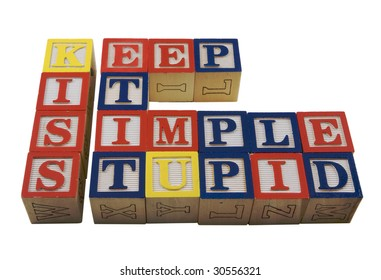 Wood Alphabet blocks spelling KISS Keep it simple stupid