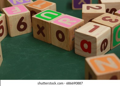 wood alphabet bricks on table.  Early learning. stripe background. Developing toys