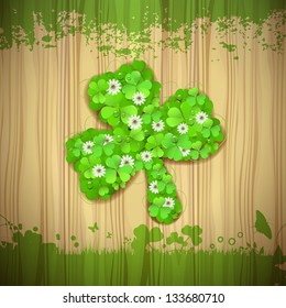 Wood background with clover for Patrick Day