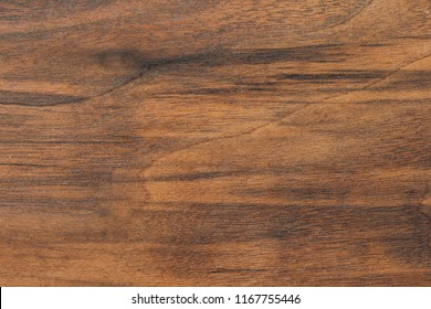 Wood background or dark brown texture. Texture of old wood use as natural background. Top view of brown black american walnut wood paneling. Copy space.