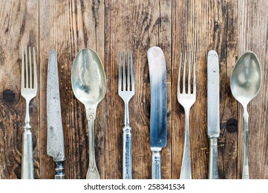 Wood background old cutlery together.