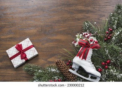 Wood background with a seasonal Christmas pine border with room for copy space
